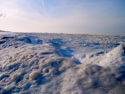 Shoreline where the waves created ice waves.
