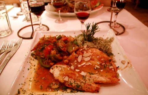 Moroccan Chicken with Apricot Breast of chicken grilled with vegetables, garbanzo. Moroccan spices, apricot sauce. Side of dill rice. Bad lighting, shaky hand.