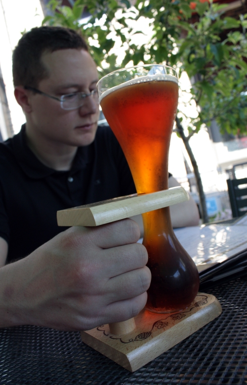 Gigantic man paws with the fancy kwak glass. Justin always looks miserable during our patio dining shots, but I assure you he was enjoying himself.