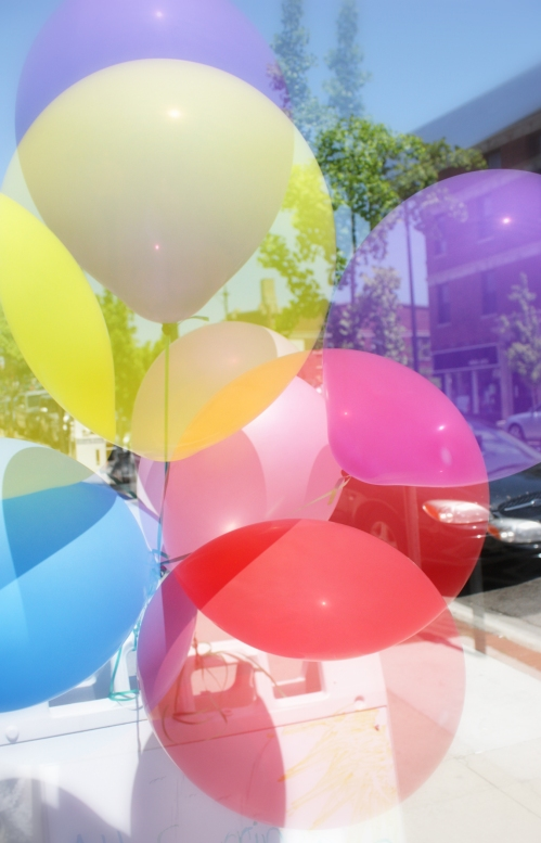 I wish I could say that these were the balloons from UP, but they are just attached to a sidewalk sale promotional sign. They will have to do.