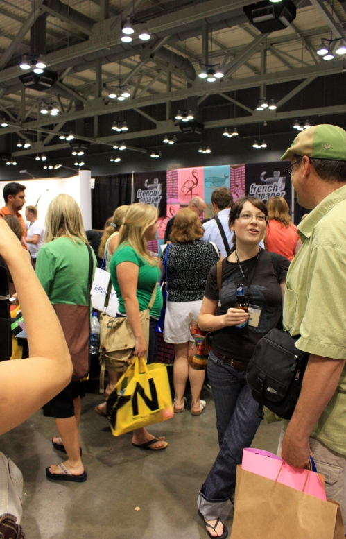 Eeeegads, the trade show. Some people LOVE these things. I have never been a huge fan, seeing as how I don't like excess stuff or overhead flourescent lighting. A word of advice to the vendors targetting designers at one of these things: Give away posters. That is all they are going to save. They will wait in a line that wraps around many booths to get your poster. They will put it up at work. The rest of the stuff is likely in the hotel garbage can. Just saying.